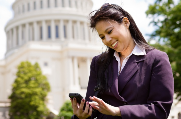 Woman on Phone in front of Capitol Hill